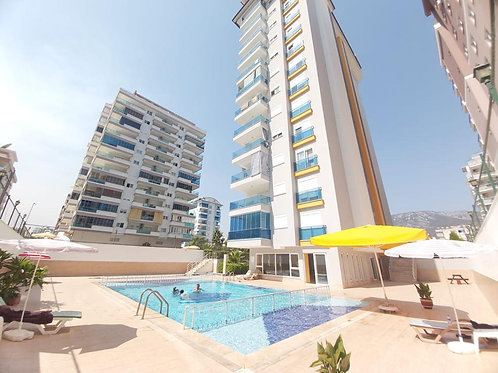 2+1 Apartment with pool and sea view in Mahmutlar, Alanya