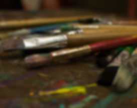 Maureen Baumhardt of Greenway Homescapes hand paints metal sculptures with these paint brushes.