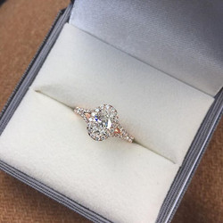 Brilliant oval diamond set in a split shank rose gold and diamond halo setting 🌹_DM or Email 💌 inf