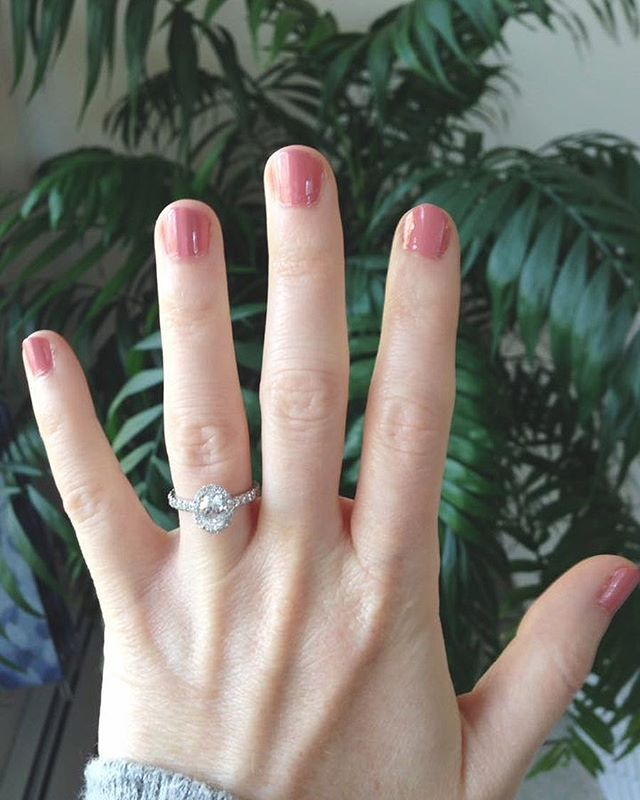 The sweetest _natty1417 rocking her beautiful new oval diamond halo engagement ring 💎