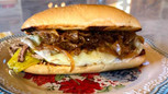 Ree Drummond's Drip Beef Sandwich with Caramelized Onions & Provolone