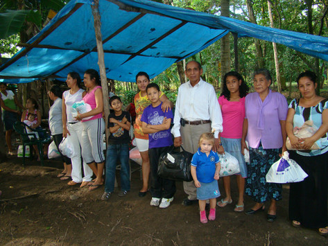 Church Community. Vicente & family pictured center-right