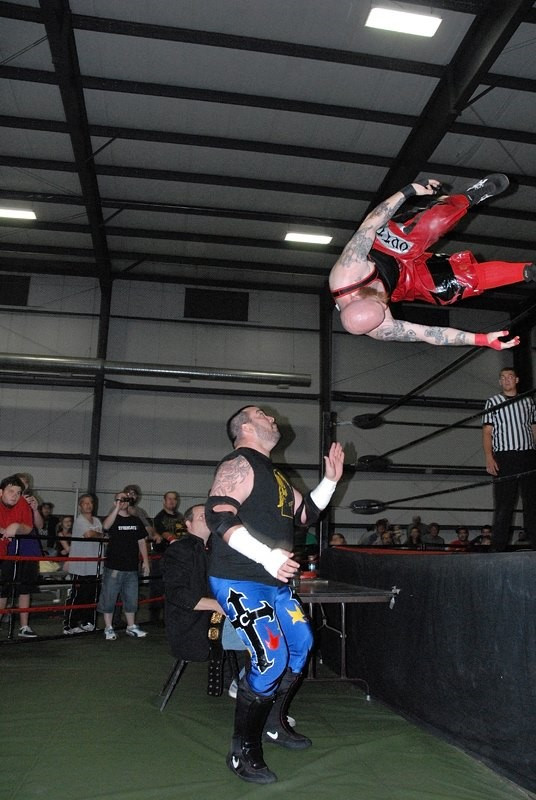 """The King of Chaos"" Ricky Cruz defends the Dynamo Pro Wrestling heavyweight championship against Outtkast (Photo courtesy of Dynamo Pro Wrestling)"