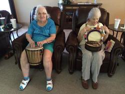 Carol, Nan's daughter reenacting Tanzania drum music