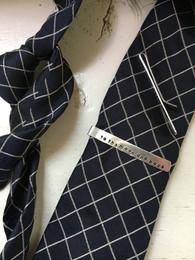 stamped tie clip