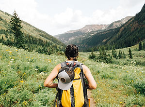 person hiking in valley