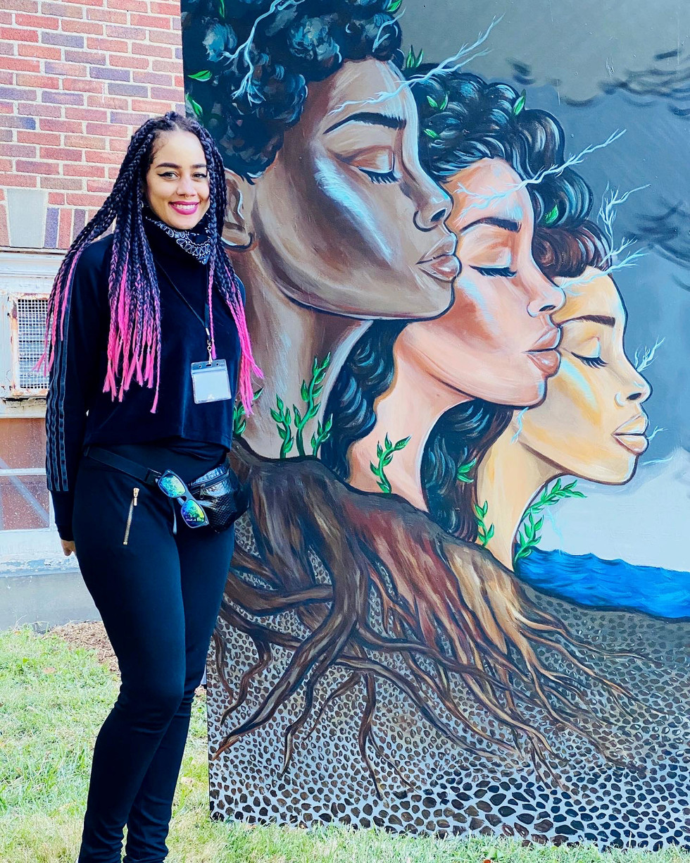 Alicia Vasquez with her mural panel