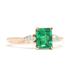 Colombian, octagnal emerald & two pear shape diamonds.  _  Set in a18ct rose gold