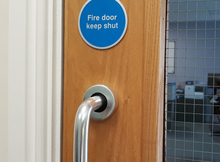 What is the difference between a regular door and a fire door?