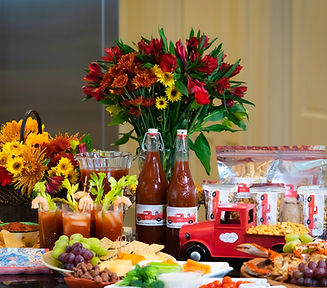 Front view of the items offered on the store page. Bloody Mary Mix, Crackers, and Rice