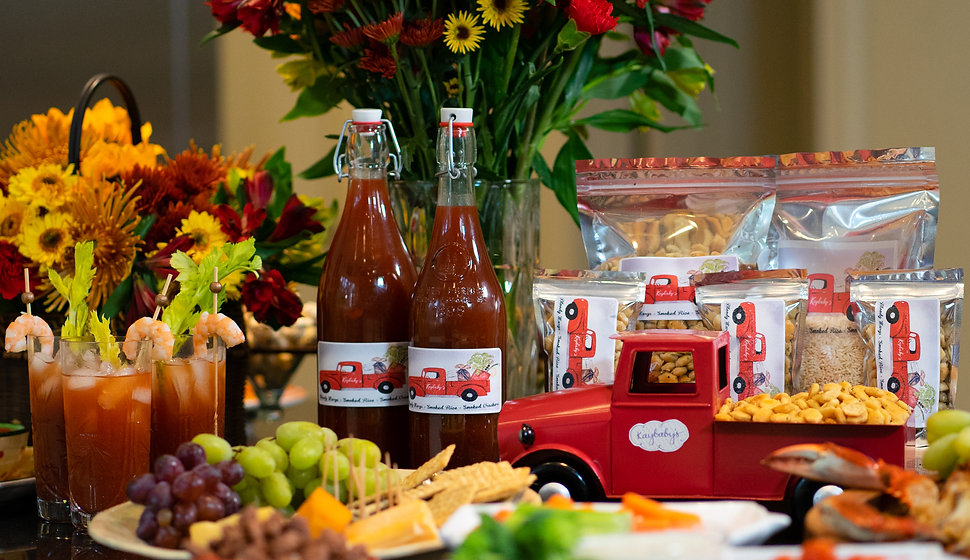 Full spread of Kaybaby products. Bloody Mary mix, crackers, and rice.