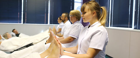 Leaners studying at temple academy of reflexology