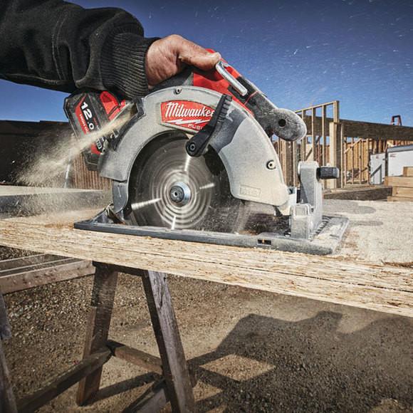 a circular saw cutting wood plates