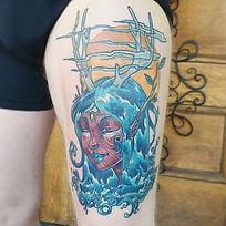 Nature goddess thigh tattoo
