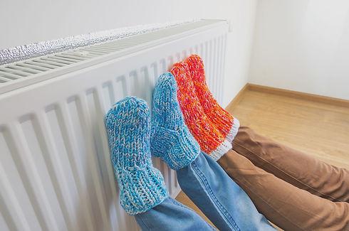 Family in warm knitted woolen socks near