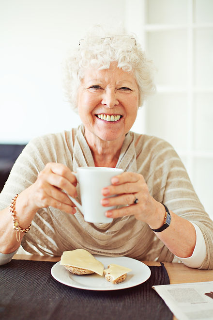 smiling-old-lady-having-her-breakfast-at