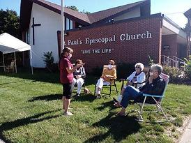 Helen talking to volunteers.jpg
