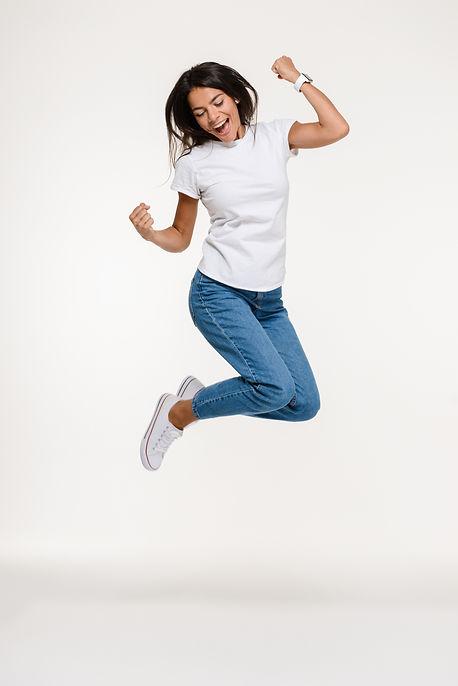 portrait-pretty-joyful-woman-jumping.jpg