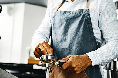 unrecognizable-man-barista-preparing-cof
