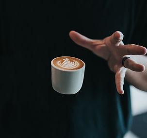 person catching white mug_edited.jpg