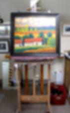 Framed Merizon painting on an easel at Merizon Studio