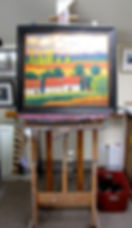 Framed Merizon painting on an easel at Merizon Studio