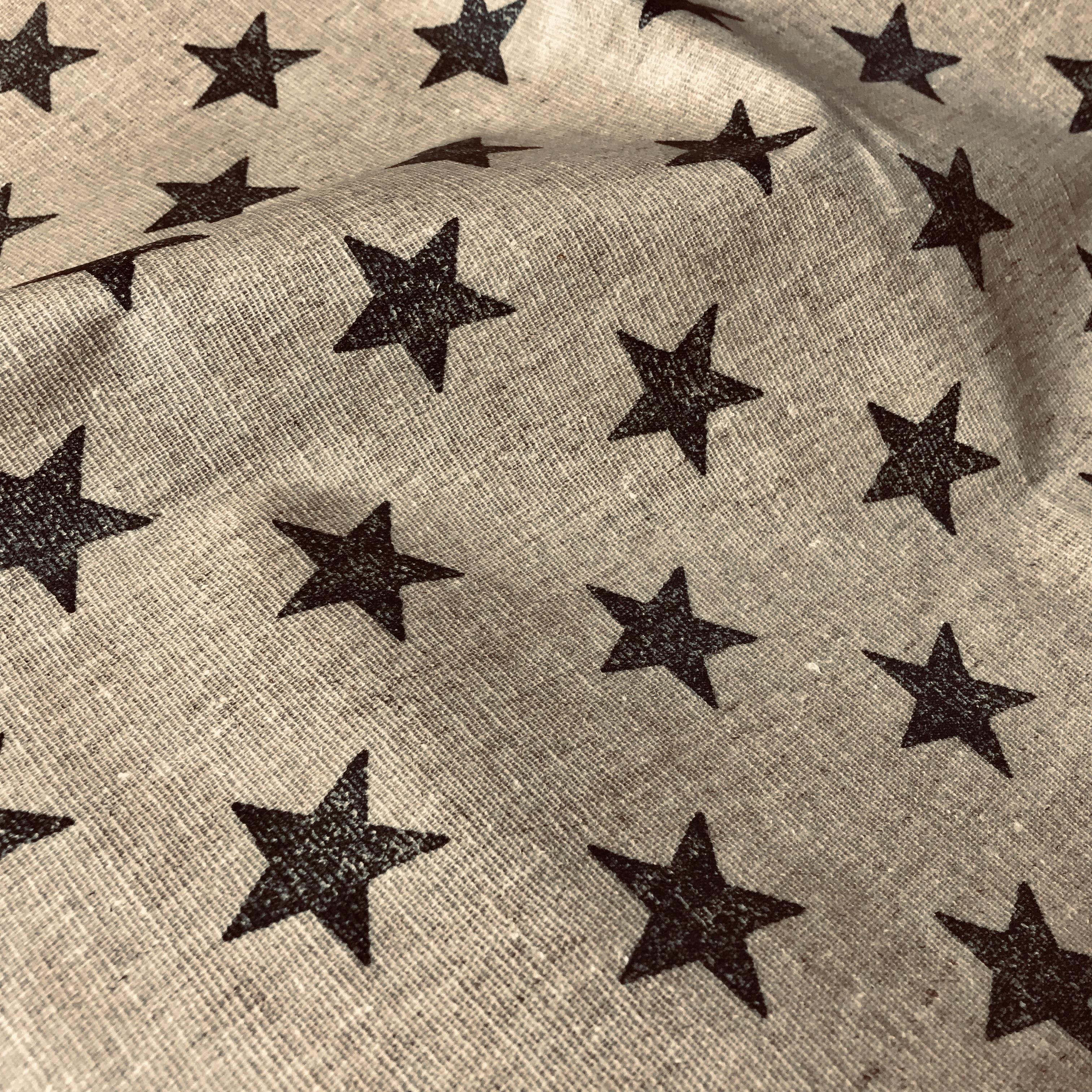 212_Canvas enduit beige à étoiles noires