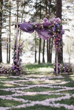 Beautiful photography of wedding arch decorated with lavender