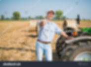 stock-photo-portrait-of-a-smiling-farmer