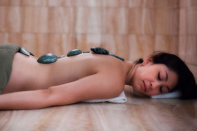 woman with jade stones on her back