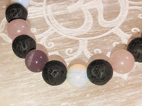 "Amethyst,  moonstone, lava stone and rose quartz 7"" bracelet"