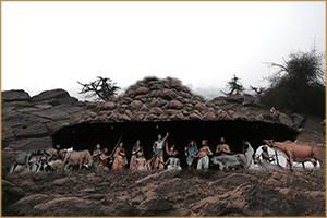 श्रीकृष्ण का गोवर्धन पर्वत को उठाकर इन्द्र् के द्वारा क्रोधपूर्वक करायी गयी घोर जलवृष्टिसे रक्षा