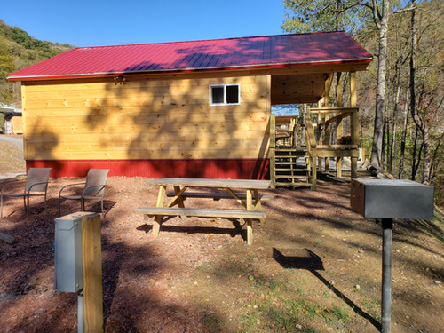 All sites include picnic table, grill, and fire pit.