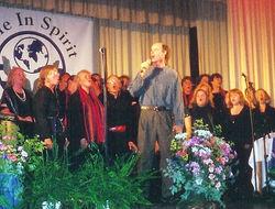 Star Tom sings with a choir
