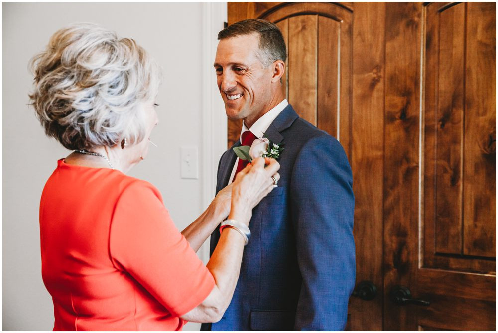 mother gets son ready for elopement
