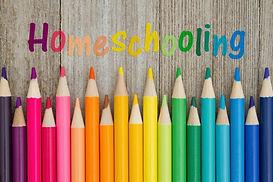 homeschool-colored-pencils-wooden-table-