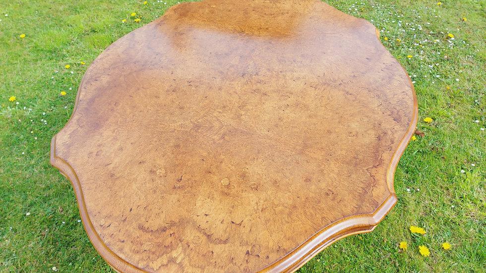 A mid Victorian walnut centre table