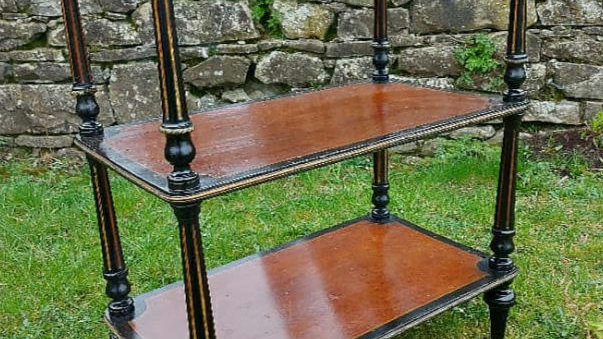 A French late 19th century walnut and ebonised etagere