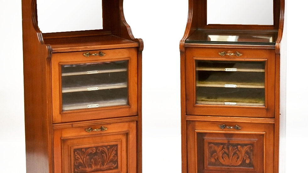A rare pair of Edwardian walnut music cabinets.
