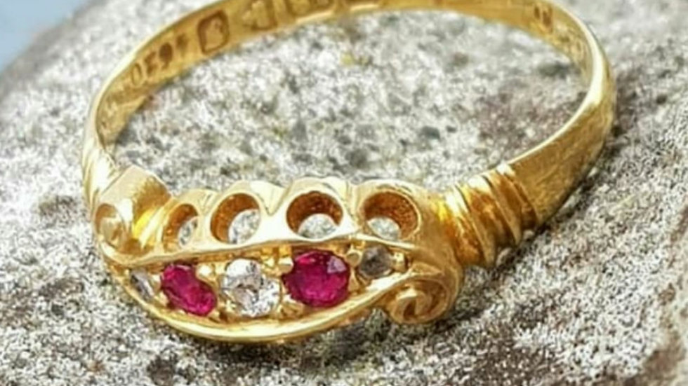 An Edwardian 18ct gold diamond and ruby ring