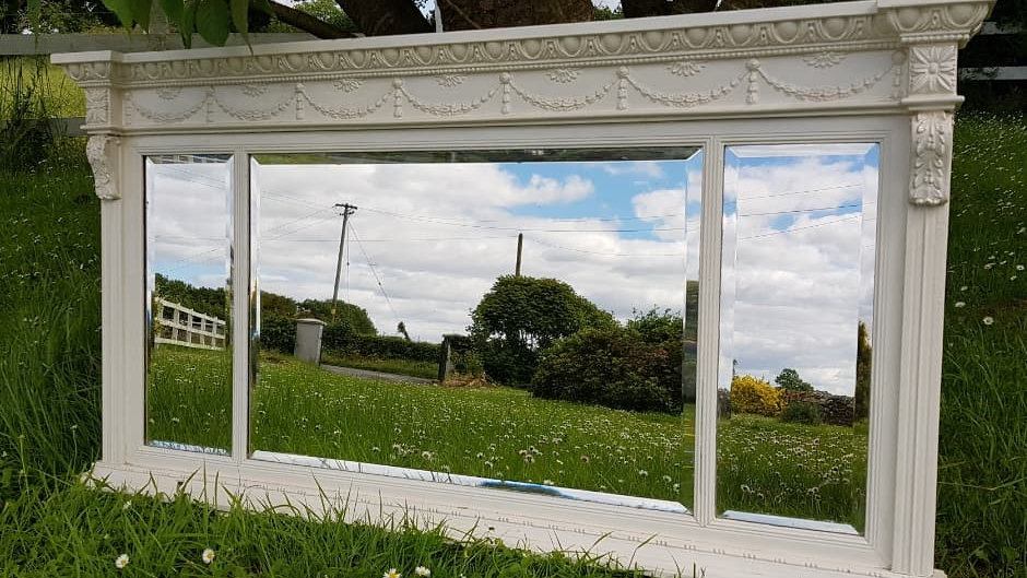 An Edwardian carved wood and painted overmantle mirror  by J. & B. Blower
