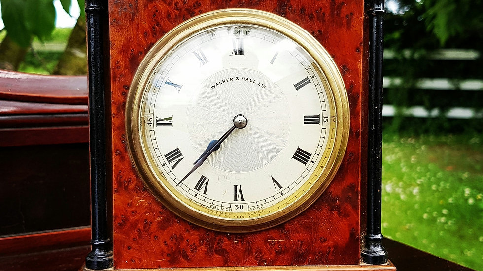 A late 19th century highly figured amboyna wood mantle clock.