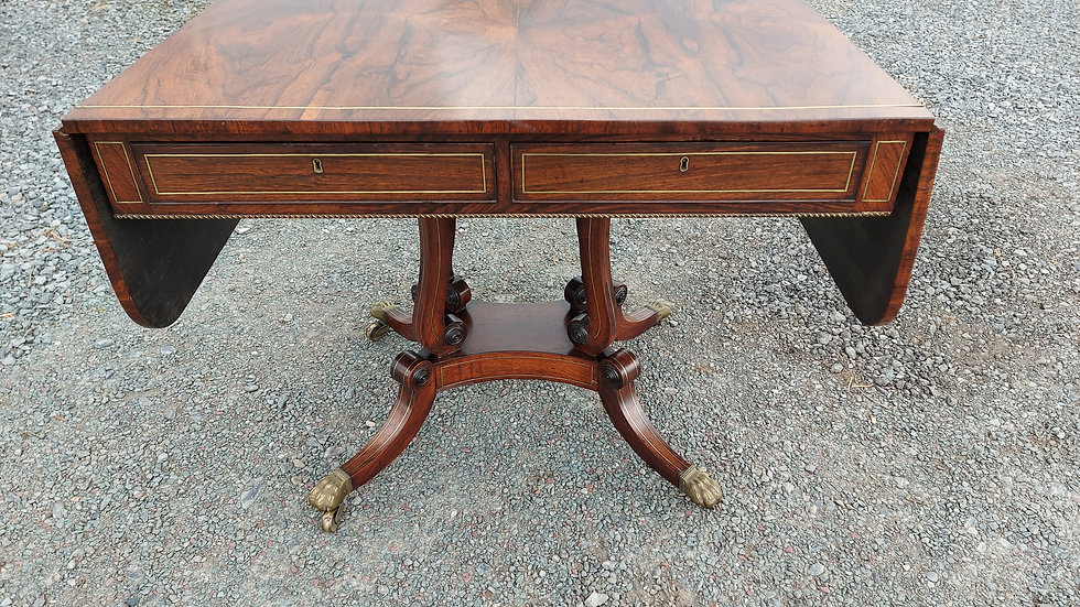 A Regency rosewood and inlaid brass sofa table.