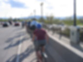 bicyclists in single fie crossing southbound on the Orange St. Bridge