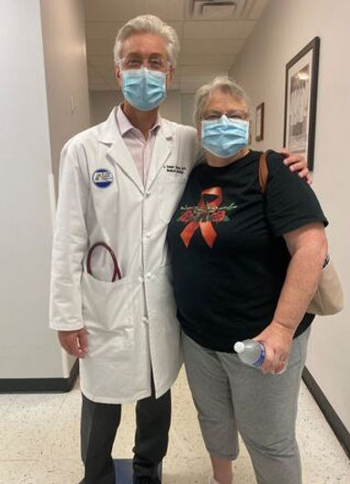 dr-cuevas-and-patient-with-masks.jpeg