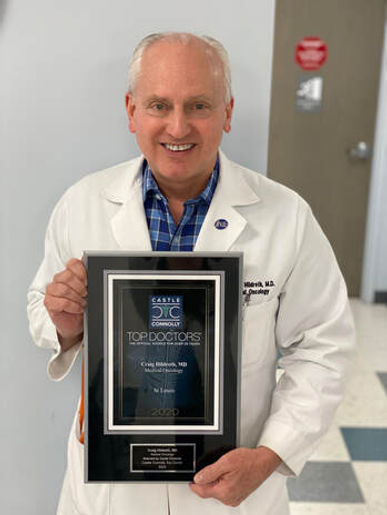 dr-hildreth-with-plaque.jpg