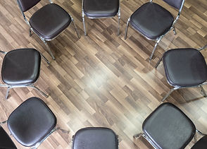 Empty chairs forming a circle (Group the
