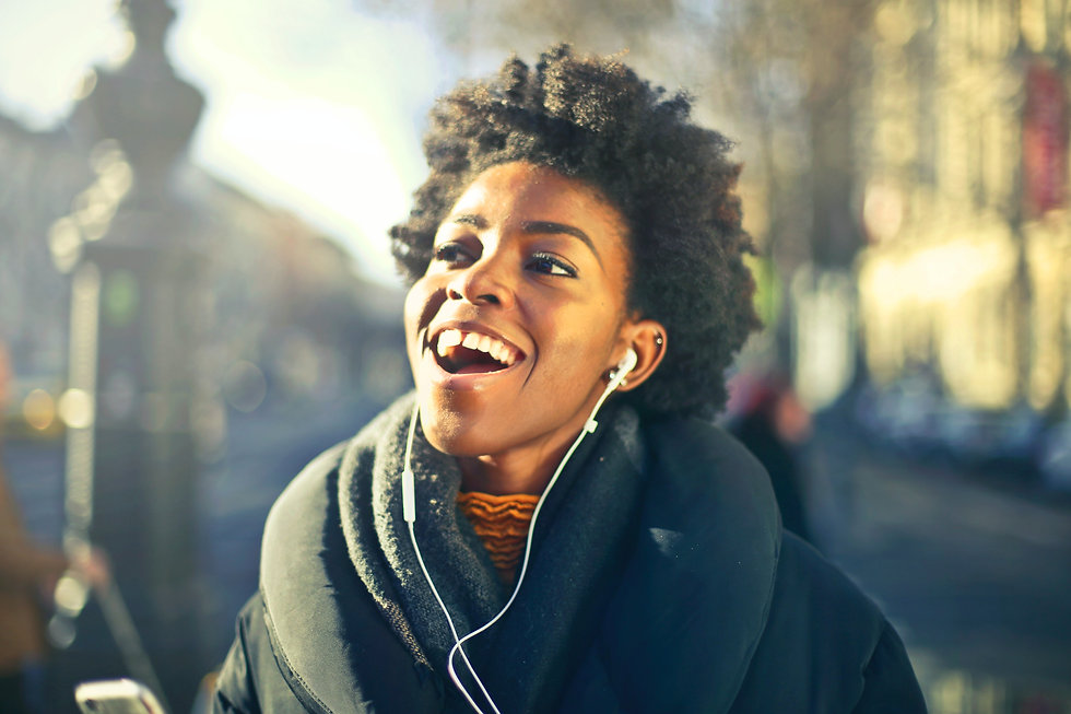 close-up-photo-of-a-woman-listening-to-m