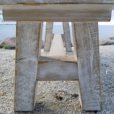 Timber and live edge trestle bench-end shot - in