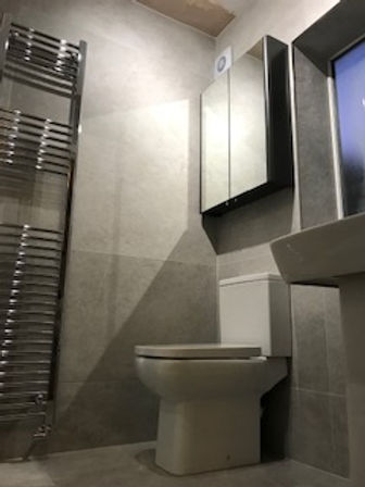 Shower room in Large format tiles.jpg